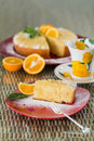 Slice of freshly cooked orange cake on red plate Royalty Free Stock Photography