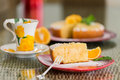 Slice of freshly cooked orange cake with spoon shugar dusting and nice background Stock Image