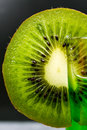 Slice of juicy ripe green kiwi Royalty Free Stock Photo