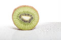Slice of kiwi with bubbles of mineral water Royalty Free Stock Photo