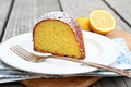 Slice lemon cake powdered sugar Royalty Free Stock Image