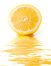 Slice of lemon with reflection in water Stock Image