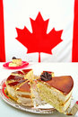 Slice of maple mousse cake for canada day celebrations a on july st the focus is on the chocolate leaf the canadian flag is Royalty Free Stock Images