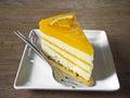 Slice of orange cake on wood background Stock Photography