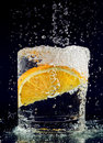 Slice of orange falling down in water Stock Photography