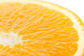 A slice of an orange fruit close on white Royalty Free Stock Photo