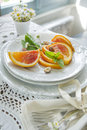 Slice of orange presentation fruit with almond Stock Photography