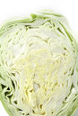 Slice pointed cabbage on a white background Stock Images