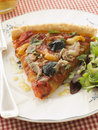 Slice of Provencale Tart with Dressed salad Royalty Free Stock Photography