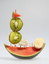 Slice of pumpkin decorated with pieces several fruits representing a sailing ship is meant to serve as decoration a buffet table Stock Photography