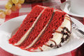 Slice red velvet cake chocolate chip icing Royalty Free Stock Photo