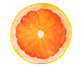 Slice of ruby grapefruit Royalty Free Stock Photo