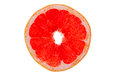 Slice of ruby grapefruit on white Royalty Free Stock Photo