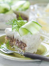 Slice of sandwich cake with tuna and cucumber selective focus Stock Image