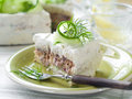 Slice of sandwich cake with tuna and cucumber selective focus Royalty Free Stock Image