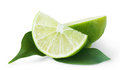 Slice of sour lime green with leaves isolated on white background Royalty Free Stock Image