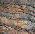 Slice of stone rocks geological background Royalty Free Stock Photo