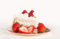 Slice of strawberry cake homemade whipped cream with strawberries on plate Stock Photos