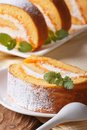 Slice of sweet carrot rolls on a plate and juice closeup vertical Royalty Free Stock Photos