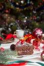Slice of sweet chocolate cake for Christmas Eve Royalty Free Stock Photo