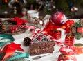 Slice of sweet chocolate cake for Christmas Eve. Christmas decoration Royalty Free Stock Photo