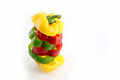 Slice the three color of bell pepper in arranged vertically on white background Royalty Free Stock Photos