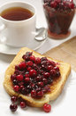 Slice toast bread with cranberry jam and cup of tea Stock Photography
