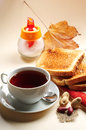 Slice toast bread and cup of tea on a colored background Royalty Free Stock Images