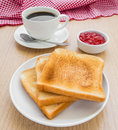 Slice of toasts, jam and coffee cup Royalty Free Stock Photo