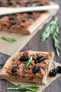Slice of tuna tart with olives and onions Stock Photo