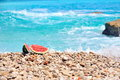 Slice of watermelon on the seashore Royalty Free Stock Photo