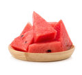 Slice of watermelon on wood plate Royalty Free Stock Photo
