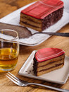 Slice of whisky cake photo a scottish and a dram on top a wood table Royalty Free Stock Photography