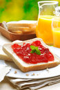 Slice of white bread and strawberry jam Stock Photos