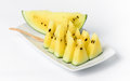 Slice yellow watermelon on dish isolated white Stock Photography