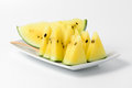 Slice yellow watermelon on dish isolated white Royalty Free Stock Photo