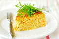 A slice of zucchini and carrot bake with rocket shallow depth of field Stock Photos