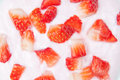 Sliced ​​fresh strawberries in yogurt closeup. Royalty Free Stock Photo