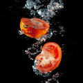 Sliced ​​tomatoes in the water Stock Photography