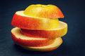 Sliced apple on black background Royalty Free Stock Photo
