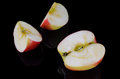 Sliced apple on a black background. Royalty Free Stock Photo