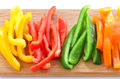 Sliced bell peppers red orange green and yellow ready for stir fry appetizer or salad Stock Photos