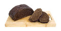 Sliced black rye bread on cutting board Stock Photo