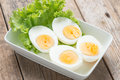 Sliced boiled eggs on white plate. Royalty Free Stock Photo