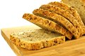 Sliced bread loaf of with grains on wood over white Stock Photo