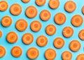 Sliced carrot on blue background