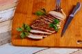 Sliced Chicken Breast fillet selective focus on wooden background