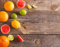 Sliced citrus fruits over wooden background set of Royalty Free Stock Photography