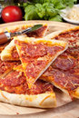 Sliced delicious pepperoni pizza and ingredients Royalty Free Stock Photo
