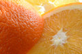 Sliced fresh orange macro view of Royalty Free Stock Photography